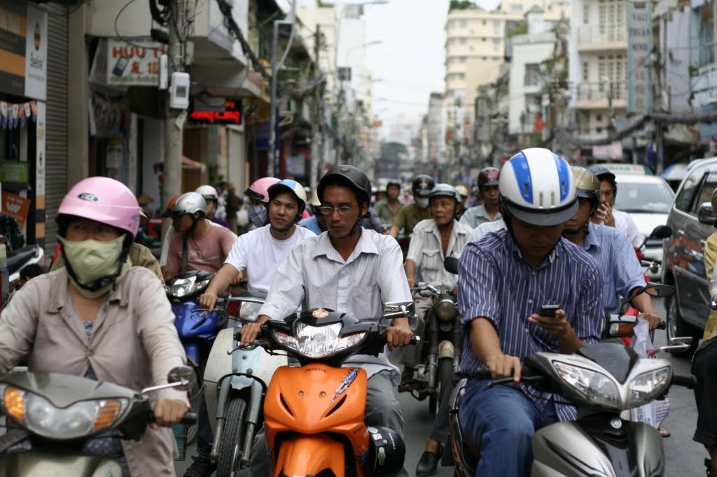 Motos y motoristas en Ho Chi Minh City, Saigon, Vietnam